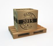 Package 2015. Wooden pallet with a package New year 2015 Stock Photography