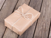 Package Wrapped in Brown Paper and String Stock Image