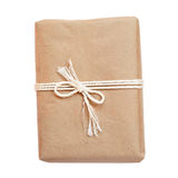 Package wrapped in kraft paper and tied with a rope Royalty Free Stock Image