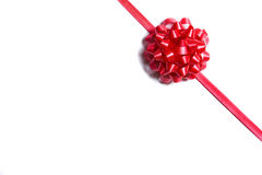 Package wrapped with a red bow Royalty Free Stock Image