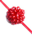 Package wrapped with a red bow Royalty Free Stock Images
