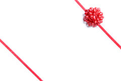 Package wrapped with a red bow Stock Photo