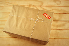 Package. Wrapped package on table top stock image