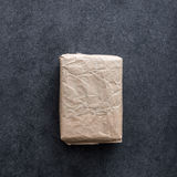 Package wrapped in wrinkled brown paper Royalty Free Stock Photo
