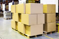 packaged boxes and cartons on wooden pallets Royalty Free Stock Images