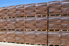 Packaged bricks on wooden pallets. Stock Photography