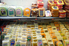 Packaged Cheeses. An assortment of packaged cheeses for sale at a supermarket in New York Stock Images