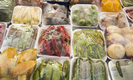 Packaged different vegetables. Packed and wrapped vegetables on plastic tray and with sheet Stock Photography