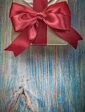 Packaged gift box on vintage wooden board greetin card celebrati Stock Image