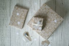 Packing of gifts for the holiday in winter. Packaged gifts lie on the table for a holiday in winter Royalty Free Stock Images