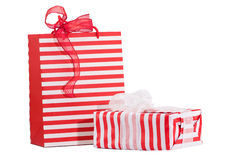 Packaged gifts  wrapped in red and white stripes. Isolated on white Stock Photo