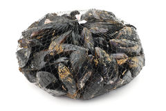 Packaged mussels. Basket with fresh mussels over white background Stock Images
