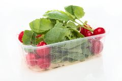 Packaged Radish from the Supermarket. A package of red radish plant from the supermarket photographed over white with a light reflection Stock Photo