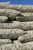 Packaged and stacked stones for industry Stock Images