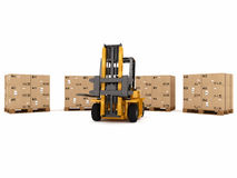 Packaged to be shipped. Small crane loading platform of packed boxes Royalty Free Stock Photo