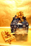 Packages. Christmas photograph taken with Merry Christmas golden foil backdrop. Sharp and colorful image. No noise. Converted from RAW Royalty Free Stock Image