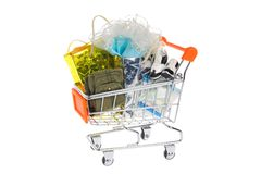 Packages with clothes in shopping cart isolated Stock Photography