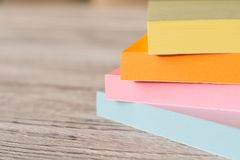 Packages of colorful stickers for notes on a wooden table.  stock image