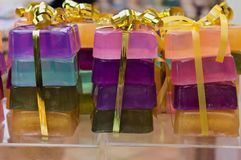 Packages of colourful soap bars, golden ribbon. stock photos