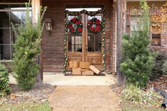 Packages on porch during holiday season stock image
