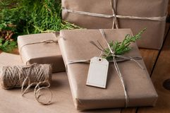 Brown paper packages wrapped up with string. Packages wrapped in brown papper and tied with string for Christmas stock photos