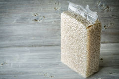 Packaging with Arborio rice on old blue boards. Horizontal Stock Photo