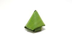 Packaging from banana leaves. For Stuffed Dough Pyramid dessert Royalty Free Stock Photography