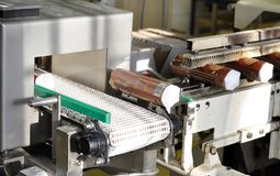 Packaging of biscuits with a machine in a factory for food produ. Ction Stock Photo