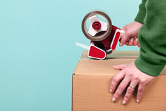 Packaging a box Stock Image