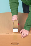 Packaging a box Stock Images