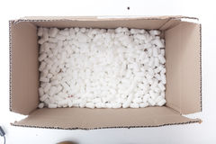 Packaging box filled with styrofoam pellets Royalty Free Stock Photos