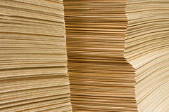 Packaging carboard close-up. Packaging carboard heap for cartons in warehouse close-up Stock Photos