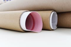 Packaging cardboard tubes with vinyl stock photo