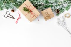 Packaging christmas gifts in boxes on white background top view.  Stock Photo