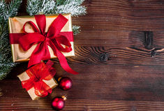Packaging christmas gifts in boxes on wooden background top view Royalty Free Stock Images