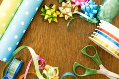 Packaging gifts on a wooden table. Birthday, decoration, christmas and hanukkah concept royalty free stock photography
