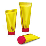 Packaging gold tubes Stock Image