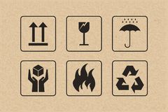 Packaging icon set of fragile care sign and symbol on brown cardboard. Stock Illustration