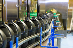 Packaging line. Empty containers are lined up on the conveyor of high-speed fill line royalty free stock photo