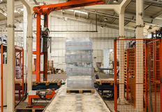 Packaging line with robotic arm Stock Image