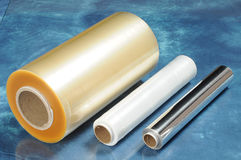 Packaging materials for food. Rolls of film for vacuum packaging of foods and food foil Royalty Free Stock Photos