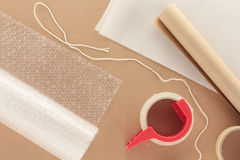Packaging Materials with String. Arrangement of Packaging Materials laid out on cardboard background Royalty Free Stock Photos