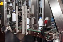 Packaging milk bottles line. Packaging bottles line in the milk industry Stock Images