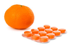 Packaging of orange pills isolated Royalty Free Stock Photo