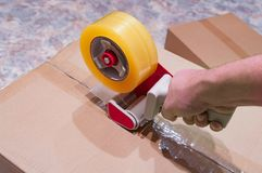 Package of parcels. Packaging parcels with dispenser close-up stock photos