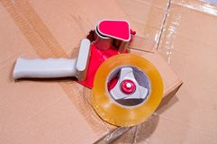 Package of parcels. Packaging parcels with dispenser close-up stock photography