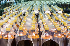 Packaging of plastic bottles. Stock Photos