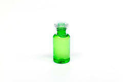 Packaging plastic clear bottle with green liquid on white background isolated. Royalty Free Stock Images