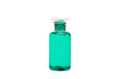 Packaging plastic clear bottle with green liquid on white background isolated. Royalty Free Stock Photography