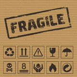 Packaging Symbols on Cardboard. Vector icons. Like: fragile, this side up, keep dry, recyclable etc stock illustration